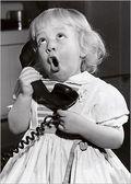 Little-girl-talking-on-phone
